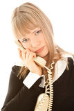 Beautiful upset businesswoman calling by phone Royalty Free Stock Photos