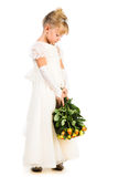 Beautiful upset little princess with flowers Stock Photography
