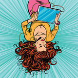 Beautiful upside down girl graphics tablet Stock Photo