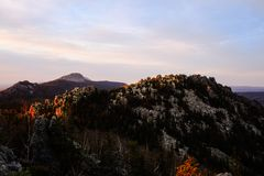 Sunset in the mountains. In the beautiful Ural mountains sunset! The rocks are illuminated by the sun. it`s an amazing landscape.Panorama of the mountains Stock Photo