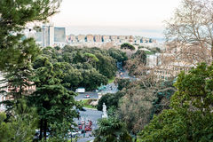 Beautiful urban view of the city of Genoa in Italy. Green natural parks and one of the main streets. Mountain view and seascape view in the far background stock photos