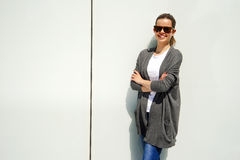 Beautiful urban woman, girl smiling in the city over white wall Royalty Free Stock Photography