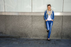 Beautiful urban woman, girl standing by the wall in city  Stock Images