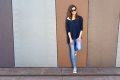 Beautiful urban woman, girl standing by the wall in city Royalty Free Stock Photo
