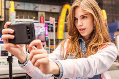 Beautiful urban woman making selfie Stock Photography