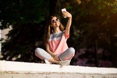 Beautiful urban woman in sunglasses make selfie portrait outdoor in summer day. stock photo