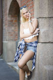 Beautiful urban young girl talking in the phone Royalty Free Stock Photography