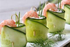 Beautiful and useful cucumber rolls with shrimp and cheese Royalty Free Stock Images