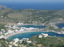 Beautiful Vacation Place. An aerial view of the blue-watered bays of Kapsali, island of Kythira, Greece, stemmed by the typical island white houses stock photography