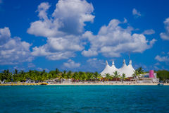 Beautiful vacation resort of Cozumel with some natural buildings and yachts, gorgeous blue ocean and sky Stock Photo