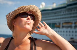 Beautiful Vacationing Woman with Cruise Ship. Beautiful Vacationing Woman on Tender Boat with Cruise Ship in the Background Stock Image