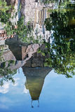 Beautiful Vajdahunyad castle is reflected in the water of the la Stock Image