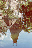 Beautiful Vajdahunyad castle is reflected in the water of the la Royalty Free Stock Photography