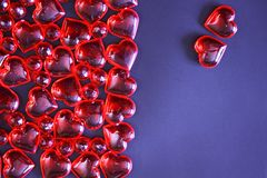 Beautiful valentines day background with red hearts on dark background. royalty free stock image