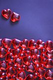 Beautiful valentines day background with red hearts on dark background. royalty free stock photo