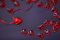 Beautiful valentines day background with red hearts on dark background. royalty free stock photos