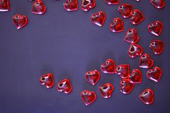 Beautiful valentines day background with red hearts on dark background. stock photos