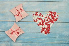 Beautiful valentines day gift box on blue wooden background. romantic background greeting card, box, strips and hearts stock photography