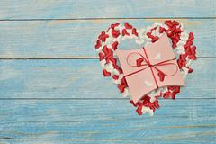 Beautiful valentines day gift box on blue wooden background. romantic background greeting card, box, strips and hearts stock photos
