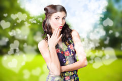 Beautiful valentines day woman. Cosmetic love. Beautiful valentines day woman with perfect hair and makeup, showing adorable surprise expression in bright green Stock Photo