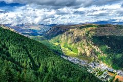 Beautiful valley near Queenston, New Zealand with high mountains. And coniferous forest on the slope stock image