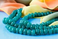 Beautiful valuable Emerald stone beads in on aquamarine backgrou Stock Images