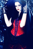 Beautiful vampire. Woman in a cape Stock Photos