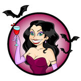 Beautiful vampire. Attractive vampire woman holding a glass of red drink Stock Photography