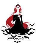 Beautiful Vampire. On a cloud of bats holding a wineglass Stock Image
