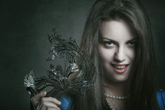Beautiful vampire with venetian mask Royalty Free Stock Images