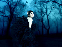 Beautiful vampire. Walks in the night forest Royalty Free Stock Photos
