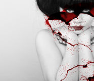 Beautiful vampire woman. With splashes of blood Stock Images