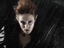 Beautiful vampire woman behind rainy window Stock Photos