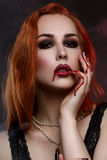 Beautiful vampire young woman Stock Photos