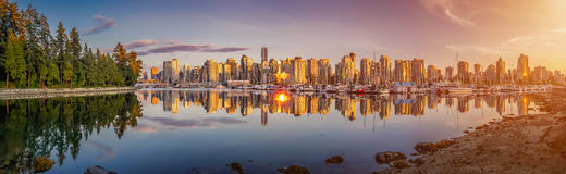 Beautiful Vancouver skyline and harbor with idyllic sunset glow, British Columbia, Canada. Panoramic view of beautiful Vancouver skyline and famous harbor area Stock Images