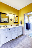 Beautiful  vanity cabinet in bright yellow bathroom Stock Photo