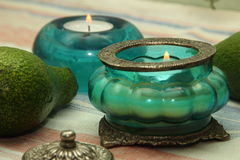 Beautiful vase, candle in oriental style. Blue and green tint Stock Photography