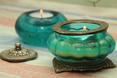 Beautiful vase, candle in oriental style. Blue and green tint Royalty Free Stock Image