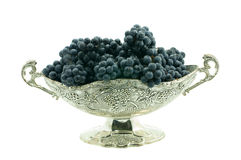 Beautiful vase with grapes. Dark grapes combined in a vase isolated on the white Royalty Free Stock Image