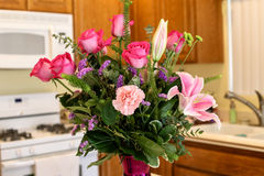 Beautiful vase of pink flowers including roses, carnations, and lillies Royalty Free Stock Photography
