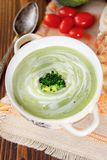 Beautiful vegetarian brocoli soup in a white bowl. Beautiful vegetarian brocoli soup in a white bowl royalty free stock photography