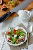 Beautiful vegetarian salad with goat cheese and figs. stock photos