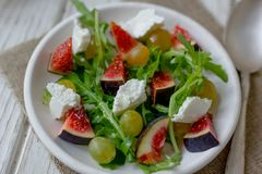 Beautiful vegetarian salad with goat cheese and figs. stock photo