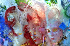 Beautiful Venetian female masks outdoor display. Lavishly decorated female carnival masks on vendor stand display,Venice Italy Royalty Free Stock Photography