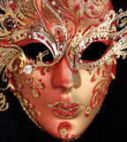 Beautiful venetian mask. Red mask from Venice on black background Stock Photography