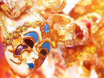 Beautiful Venetian mask. Decorated with gold, traditional carnival face accessory, fashion lifestyle, art and fantasy concept royalty free stock photo