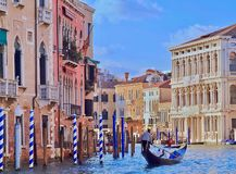Beautiful Venice with a gondola on Canale Grande. Beautiful Canale Grande in Venice in the morning with a Gondola royalty free stock image