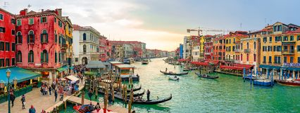 Beautiful Venice narrow canals, with many classic gondolas. Amazing old rusty buildings, near old cathedral of Santa Maria della Salute royalty free stock photos