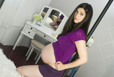 Beautiful Very Pregnant Woman Shows Belly in Bedroom Vanity Mirr Royalty Free Stock Photos