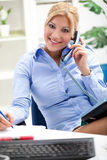 Beautiful and very secretary working in office Stock Images